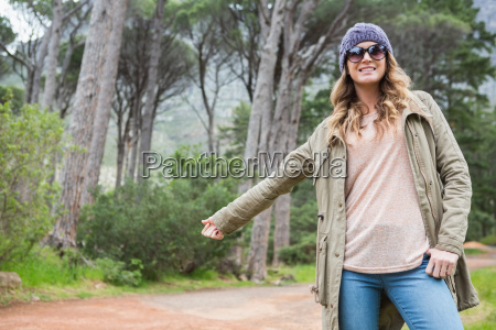 hitch hiking woman with sunglasses
