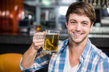 portrait of smiling man drinking a