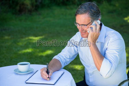 casual, businessman, taking, notes, and, having - 17530994