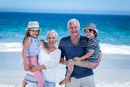 happy grandparents giving piggy back to