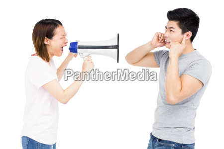 angry woman shouting at young man