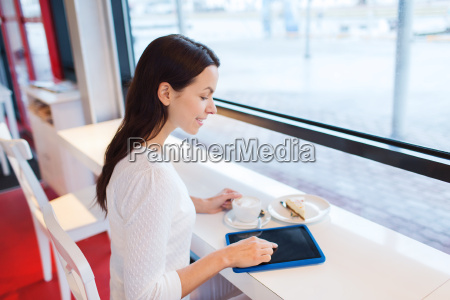 smiling woman with tablet pc and