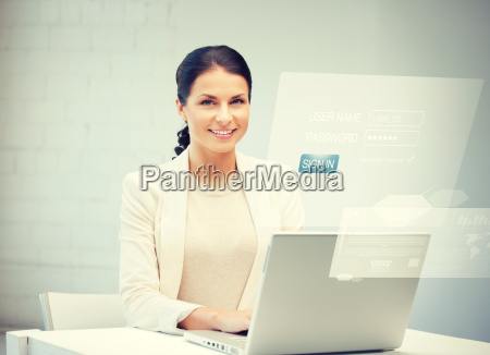 woman with laptop computer and virtual