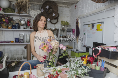 female owner making flower bouquet at