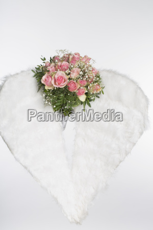 flower bouquet and angel wings against