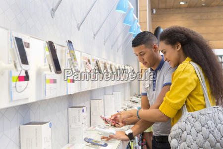 store assistant helping female customer in