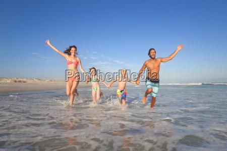 happy family running toward camera through