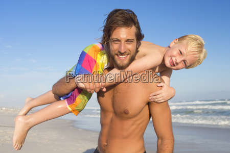 portrait of father with son on