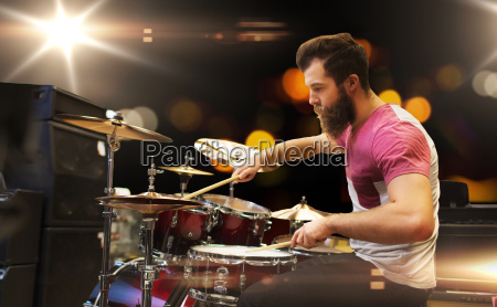 male musician playing cymbals at music