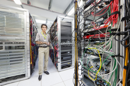 technician looking at camera holding laptop