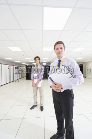 manager and technician looking at camera