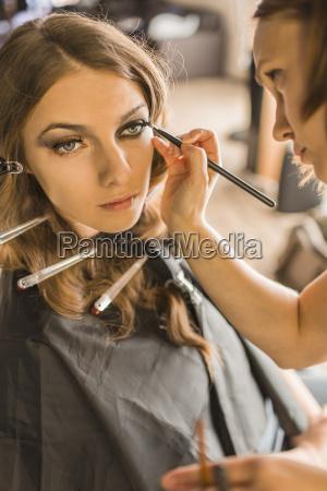 make up artist applying eyeliner on