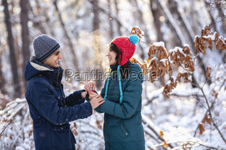 playful young couple holding hands during