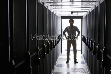 technician standing in aisle of storage