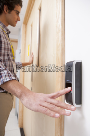 man using finger print entry technology