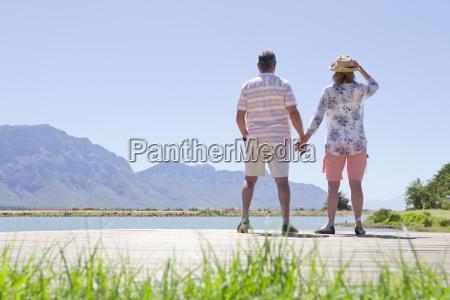 senior couple standing hand in hand
