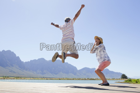 senior couple on wooden jetty by