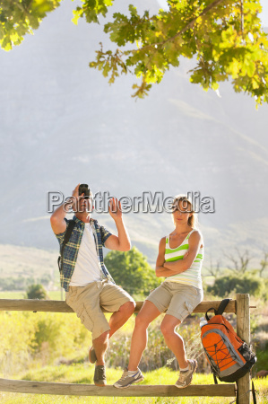couple out for walk resting on