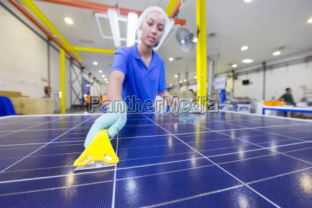technician worker cleaning new solar panel