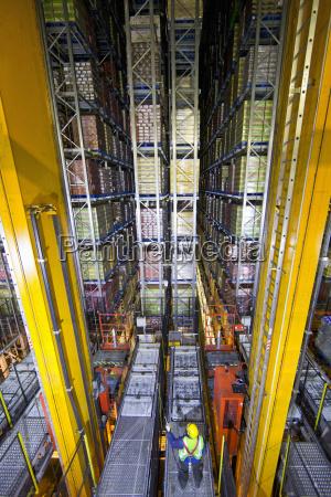 worker below foodstuffs merchandise stored in