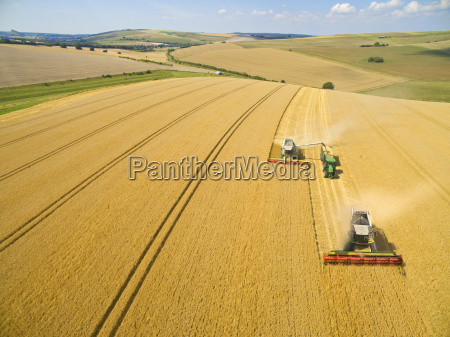 aerial view of combine harvesters and