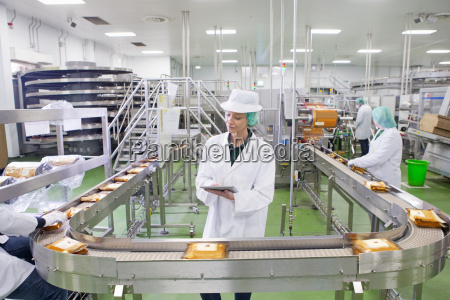 quality control worker with digital tablet