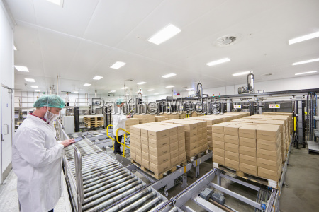 workers with digital tablets at food
