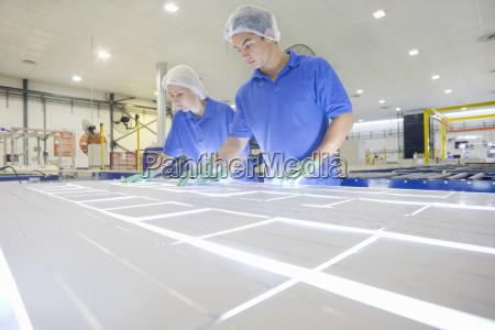 technician worker arranging solar cells to