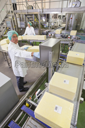 worker at production line control panel