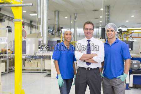 businessman and technicians smiling at camera