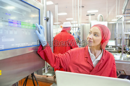 worker using touch screen control panel
