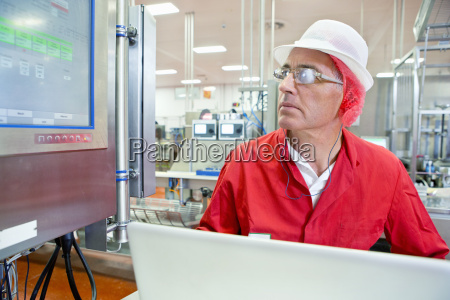 worker watching control panel computer monitor