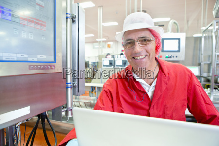 portrait smiling worker at control panel