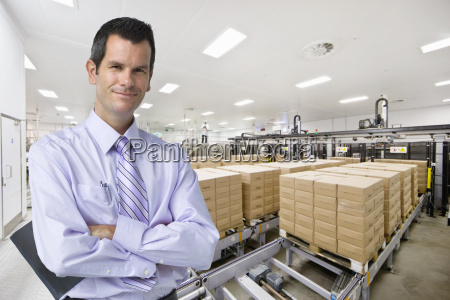 portrait of smiling businessman at food