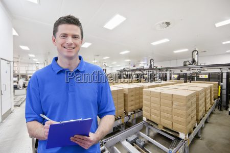 portrait of smiling worker with clipboard