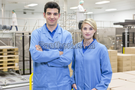portrait of smiling workers at food
