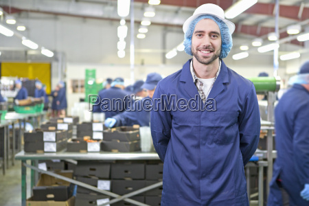 portrait confident worker in food processing