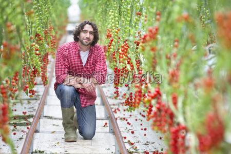 portrait confident worker between rows of
