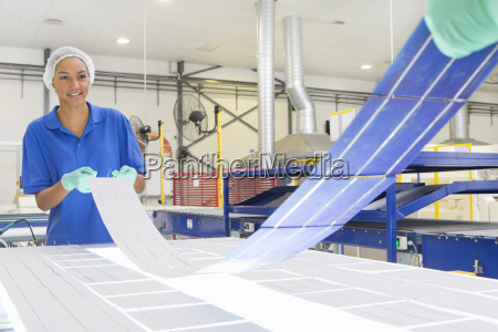 technicians arranging solar cells to form