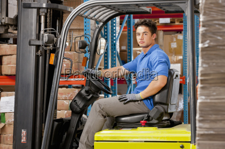 portrait of forklift truck driver looking