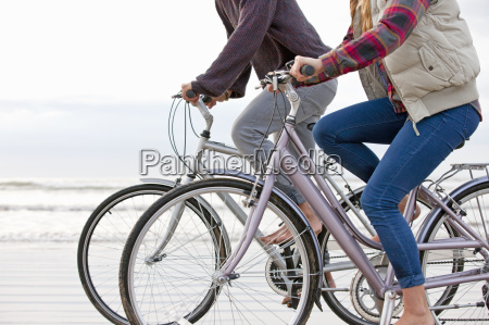 cropped view of couple riding bicycles