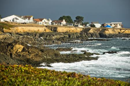 waves crash on the rocky coast