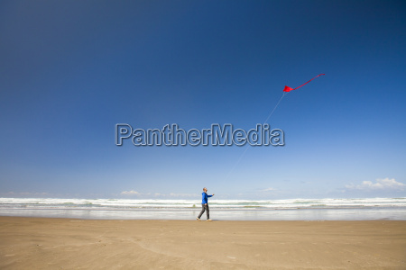 a young man flys a red