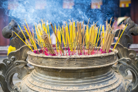 burning incense sticks at thien mu
