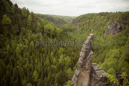 climbing a sand stone tower at