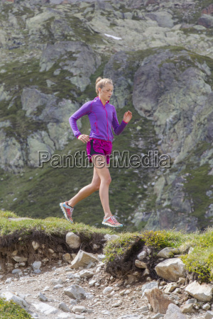 girl trail running in chamonix on