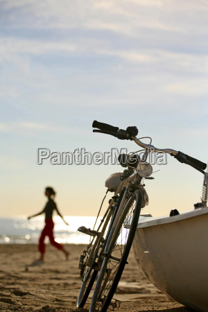 blond girl and bicycle on promenade