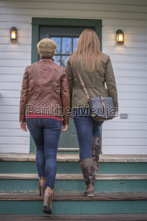 two women in fashionable clothing explore