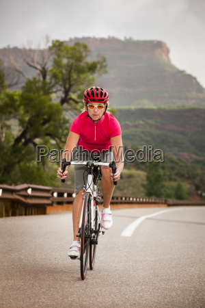women road cyclist rides her road