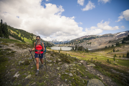 a young woman hiking near helm